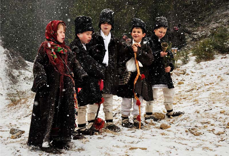 Caroling dressed in traditional Romanian clothes